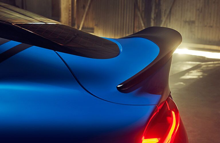 The rear side view of a blue 2021 Toyota GR Supra.