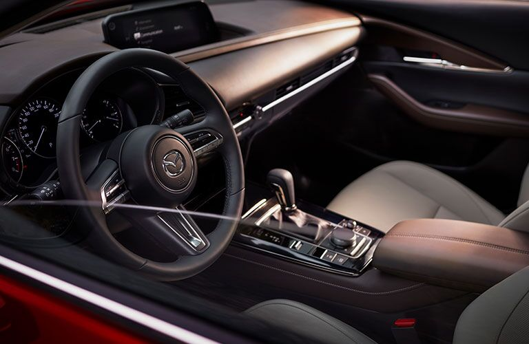 Interior view of the steering wheel inside a 2020 Mazda CX-30