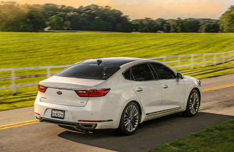 Exterior view of the rear of a white 2019 Kia Cadenza