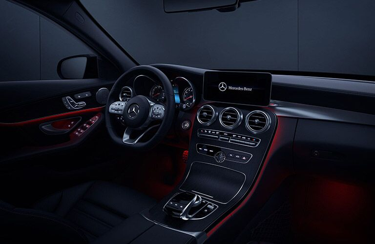 2020 MB C-Class interior front cabin steering wheel dashboard with red ambient lighting