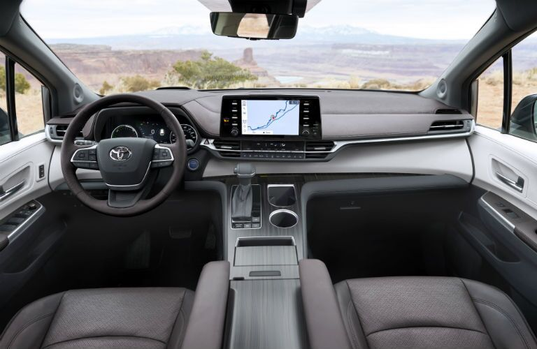 A photo of the driver's cockpit and the dashboard in the 2021 Toyota Sienna.
