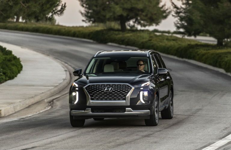 A head-on photo of the 2021 Hyundai Palisade on the road.
