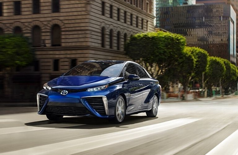 2020 Toyota Mirai driving down city street during day