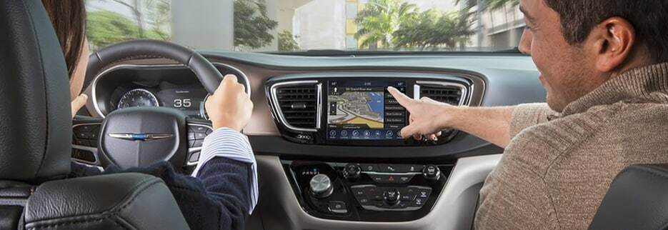 Guys pointing to the GPS in a Chrysler Pacifica
