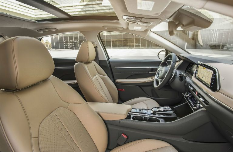 An interior image of the front seats of the 2020 Hyundai Sonata in a tan color combination.
