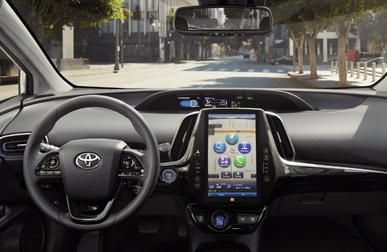 Interior view of the steering wheel and touchscreen display inside a 2021 Toyota Prius