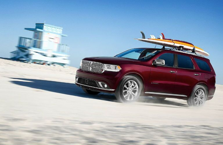 A photo of the 2020 Dodge Durango driving on the beach.