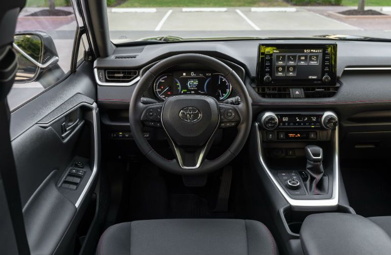 A photo of the driver's cockpit of the 2021 Toyota RAV4 Prime.