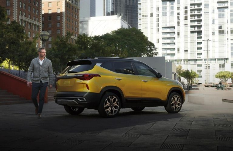 Exterior view of the rear of a yellow 2021 Kia Seltos