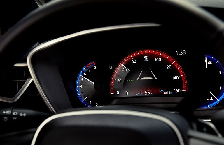 Digital gauges behind the wheel of the 2021 Toyota Corolla