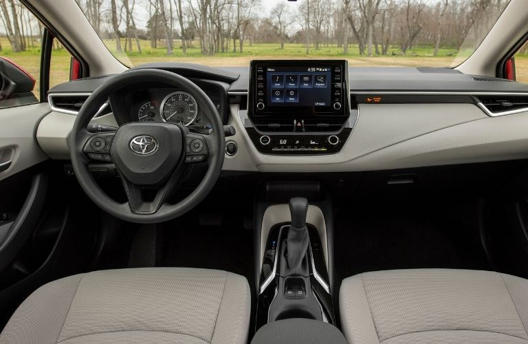 Interior view of the front seating area inside a 2020 Toyota Corolla
