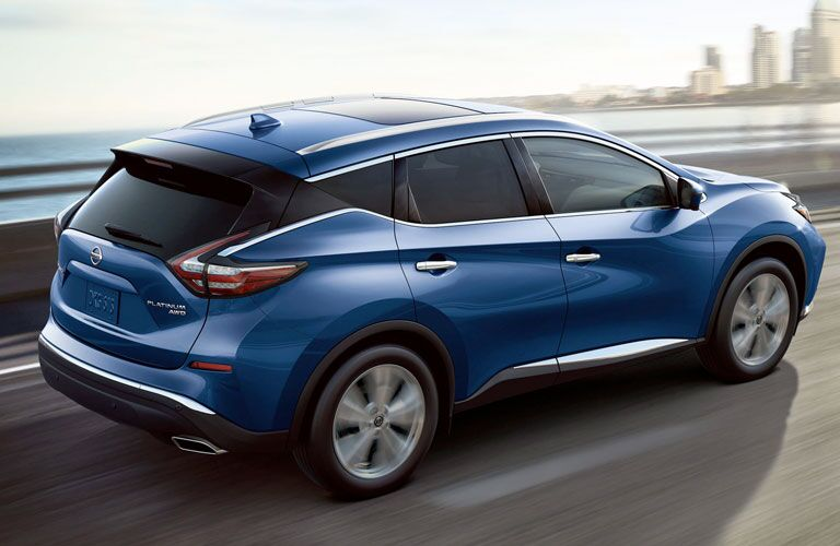 Blue 2020 Nissan Murano with a city skyline in the background
