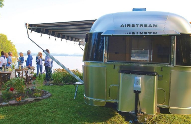 2020 Airstream Globetrotter parked by lake