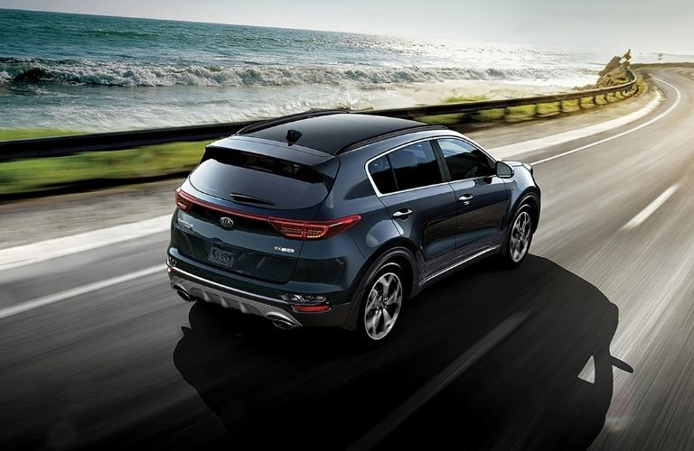 Exterior view of the rear of a blue 2021 Kia Sportage