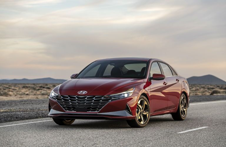 The front side of a dark red 2021 Hyundai Elantra.
