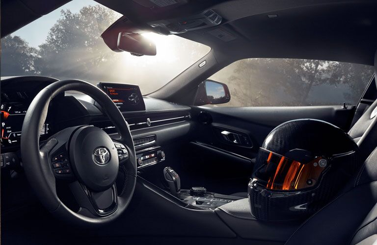 Interior view of the front seating area inside a 2020 Toyota Supra