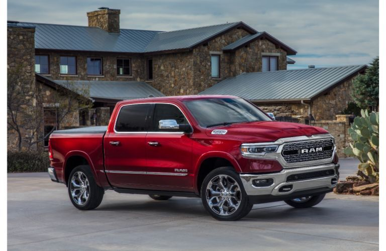 The front and side view of a red 2021 RAM Limited trim level.