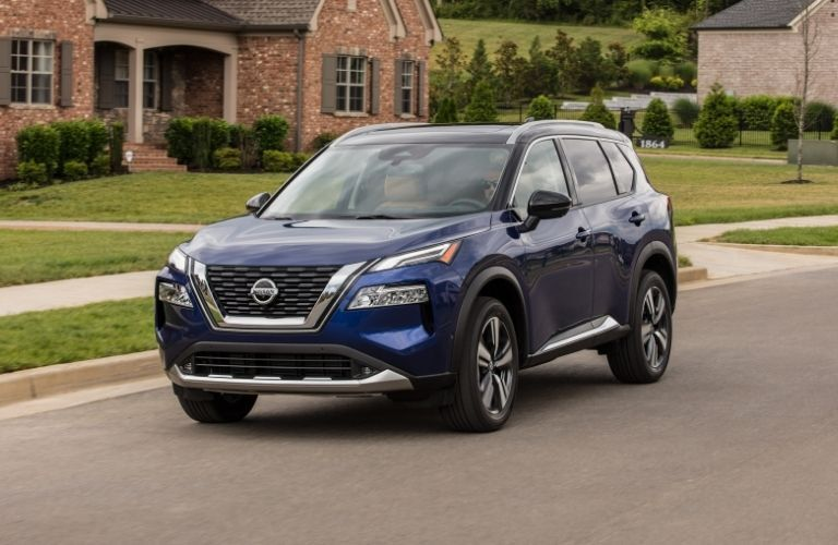 Exterior view of the front of a blue 2021 Nissan Rogue