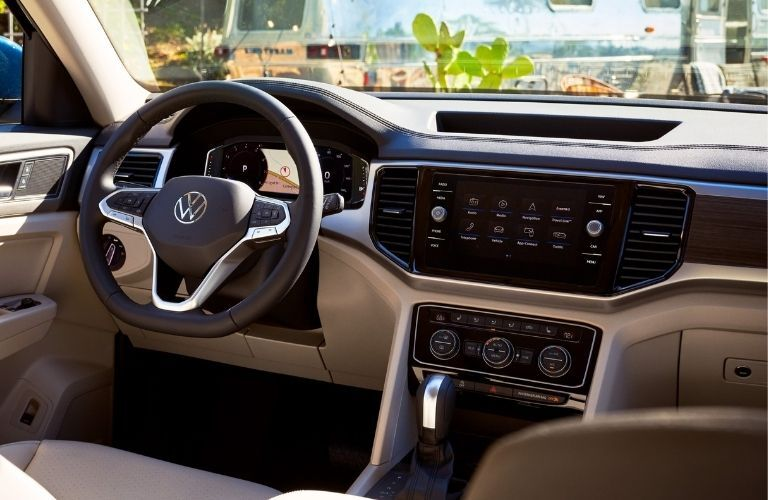 Interior view of the steering wheel and touchscreen display inside a 2021 Volkswagen Atlas