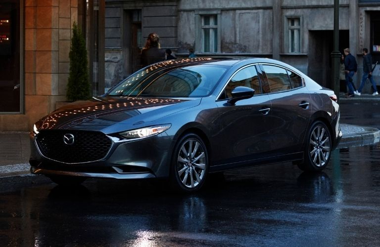 Exterior view of the front of a gray 2021 Mazda3 Sedan