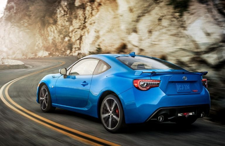 rear view of 2020 Toyota 86 driving around a curve