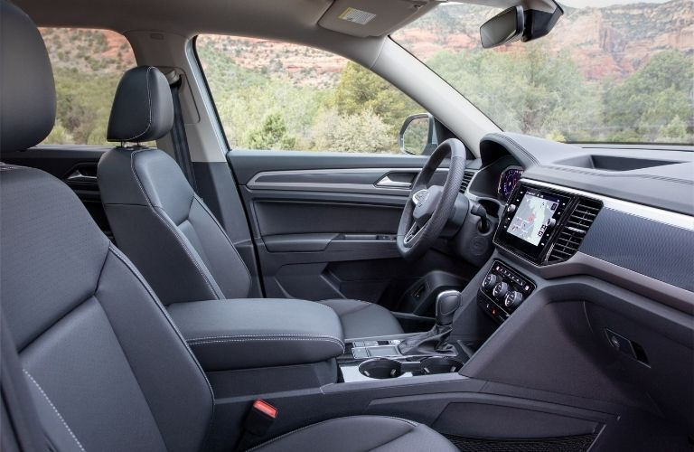 Interior view of the front seating area inside a 2021 Volkswagen Atlas