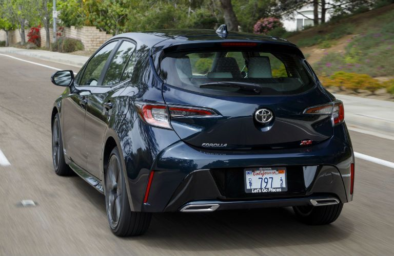 A rear photo of the 2020 Toyota Corolla Hatchback on the road.