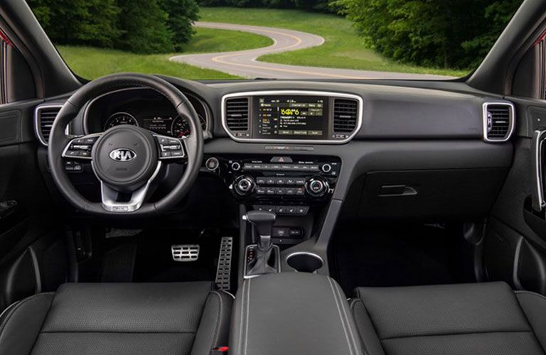 Interior view of the steering wheel and touchscreen display inside a 2021 Kia Sportage