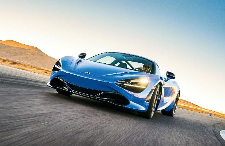 2020 McLaren 720S blue exterior front driver side driving on track_o