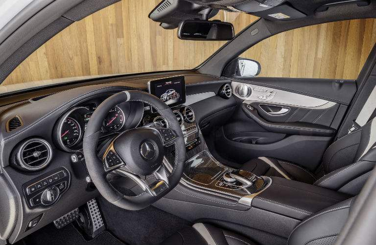 A photo of the driver's cockpit in the 2018 Mercedes-Benz AMG GLE Coupe.
