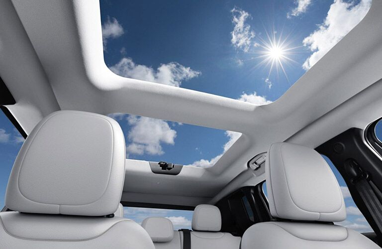 A rear interior view of the panoramic sunroof inside a 2020 Jeep Renegade.