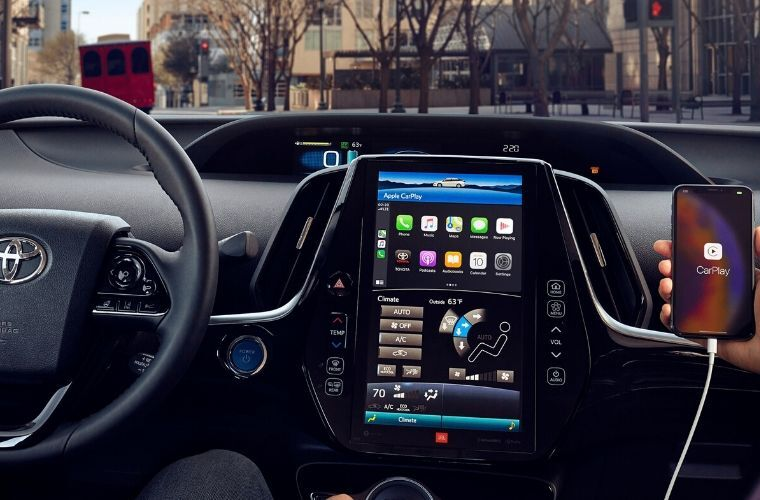 2020 Toyota Prius Prime infotainment screen showing Apple CarPlay connected to a smartphone