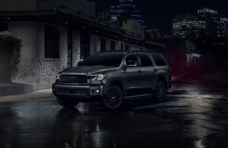 A 2021 Toyota Sequoia driving on a road at night