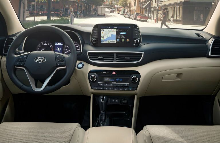 The interior front seats and driver area of the 2021 Hyundai Tucson