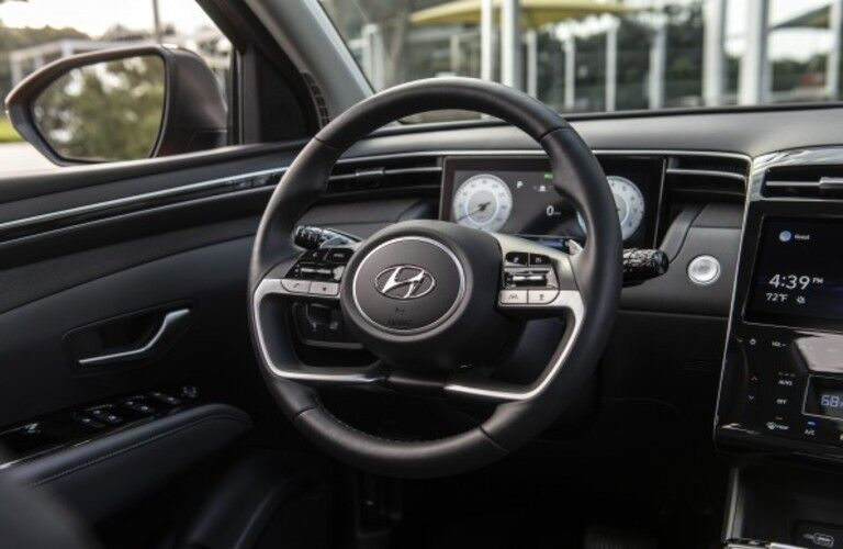 The front interior steering wheel inside the 2022 Hyundai Tucson.