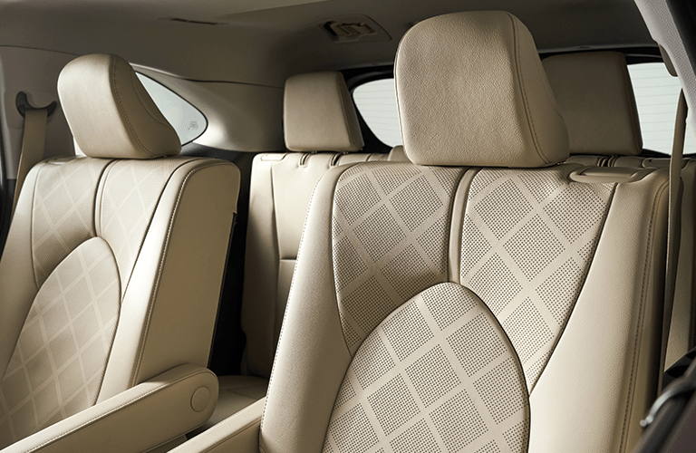 Interior view of the tan seating available inside a 2020 Toyota Highlander