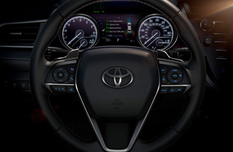 Close Up View of the Steering Wheel and Dashboard in the 2019 Toyota Camry