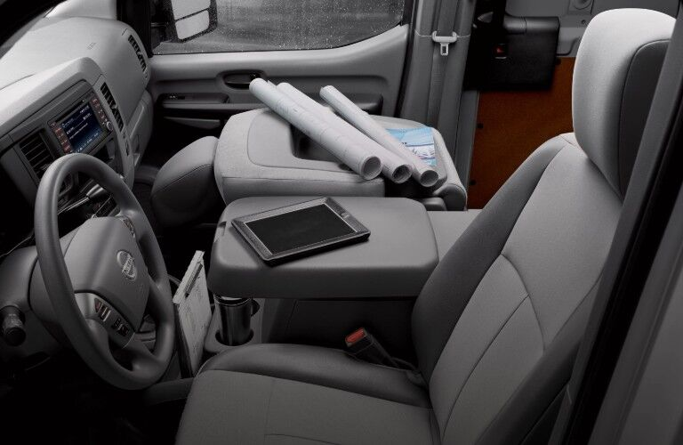 Driver angle of the front row interior with work supplies inside the 2020 Nissan NV2500 HD