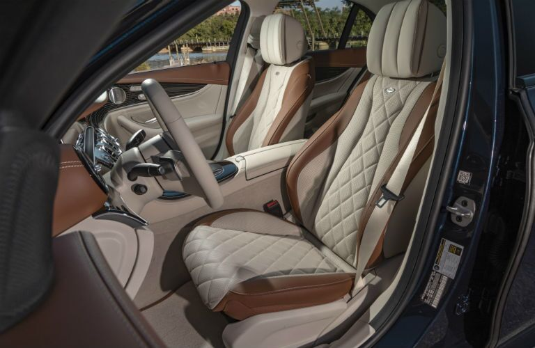 A photo of the front seats in the 2021 Mercedes-Benz E 350 4MATIC®.