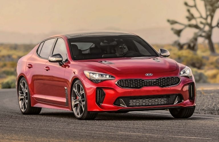 Exterior view of the front of a red 2021 Kia Stinger