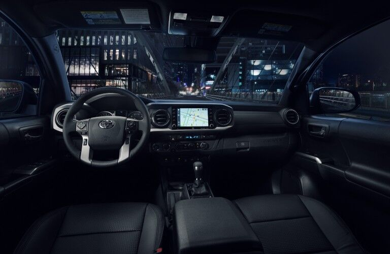 A photo of the driver's cockpit and dashboard in the 2021 Toyota Tacoma.