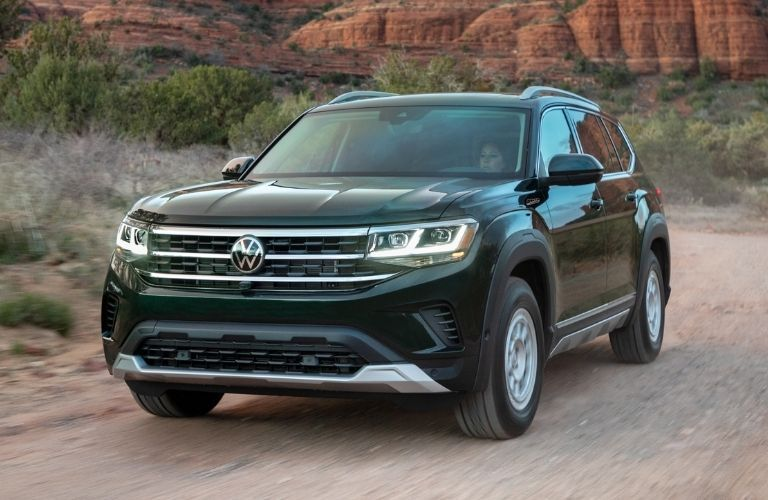 Exterior view of the front of a green 2021 Volkswagen Atlas