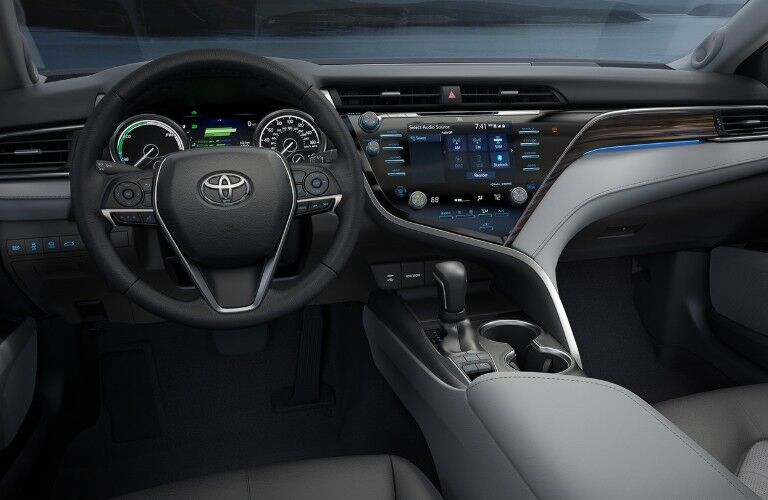 Close up of the steering wheel and dashboard inside the 2020 Toyota Camry