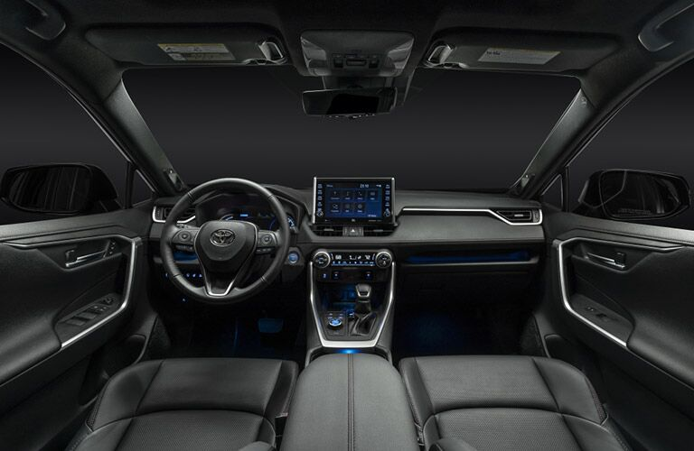 Steering wheel, gauges, and touchscreen in 2021 Toyota RAV4 Prime