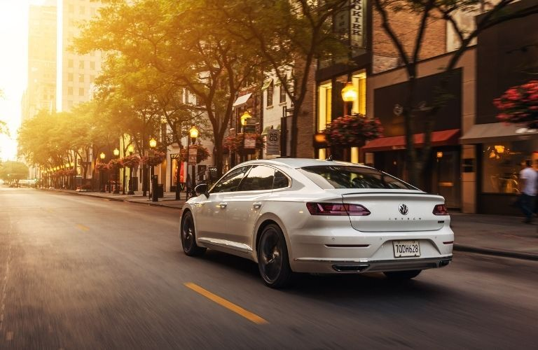 2020 VW Arteon driving toward sunlight