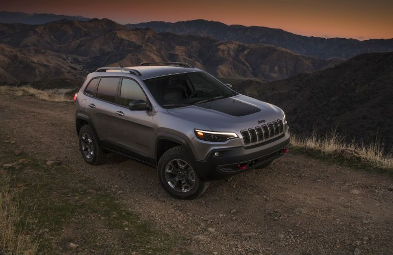 Jeep Cherokee driving on dirt road
