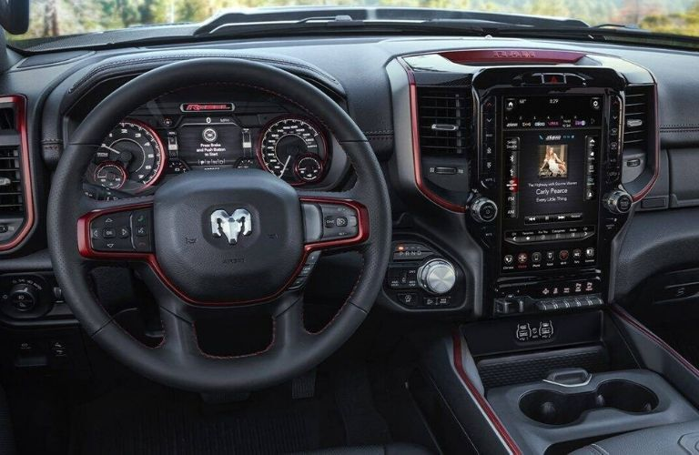 Interior view of the steering wheel and touchscreen display inside a 2020 RAM 1500