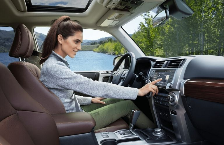 woman using media display in 2020 Toyota 4Runner