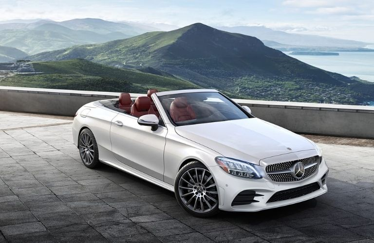 2021 MB C-Class Cabriolet exterior front fascia passenger side in front of mountain