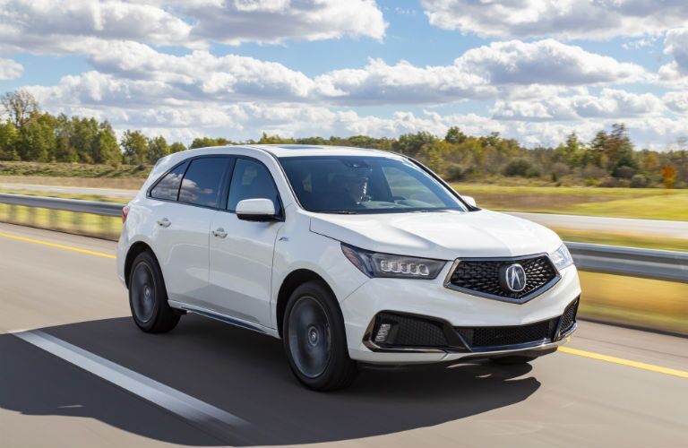 A front right quarter photo of the 2020 Acura MDX on the road.